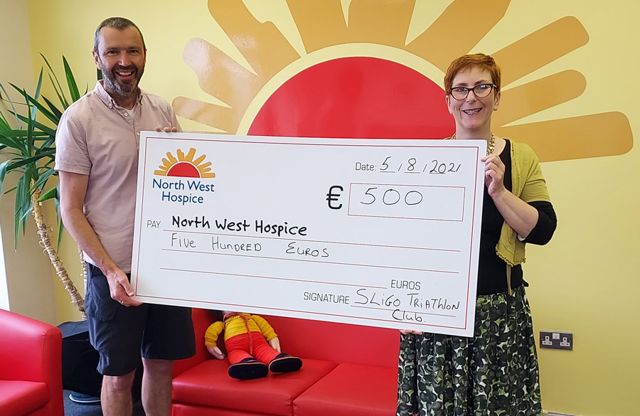 Presenting cheque to North West Hospice Charity 2021
