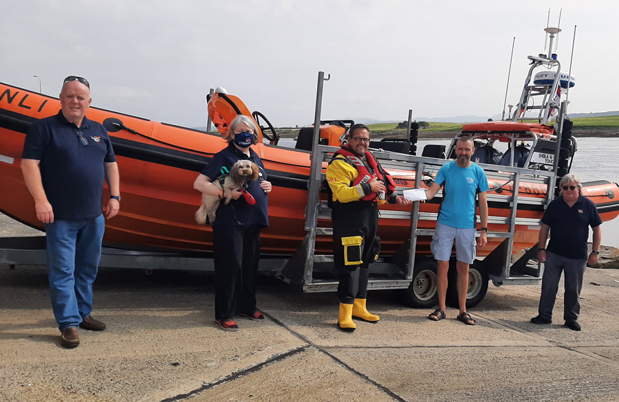 Presenting cheque to RNLI